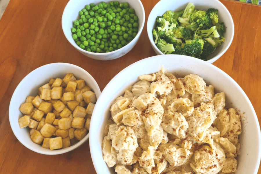 Lunch at Sustainable Play Preschool: Creamy cauliflower pasta shells with broccoli, peas and baked tofu nuggets