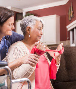 Home healthcare nurse, physical therapy with senior adult woman.
