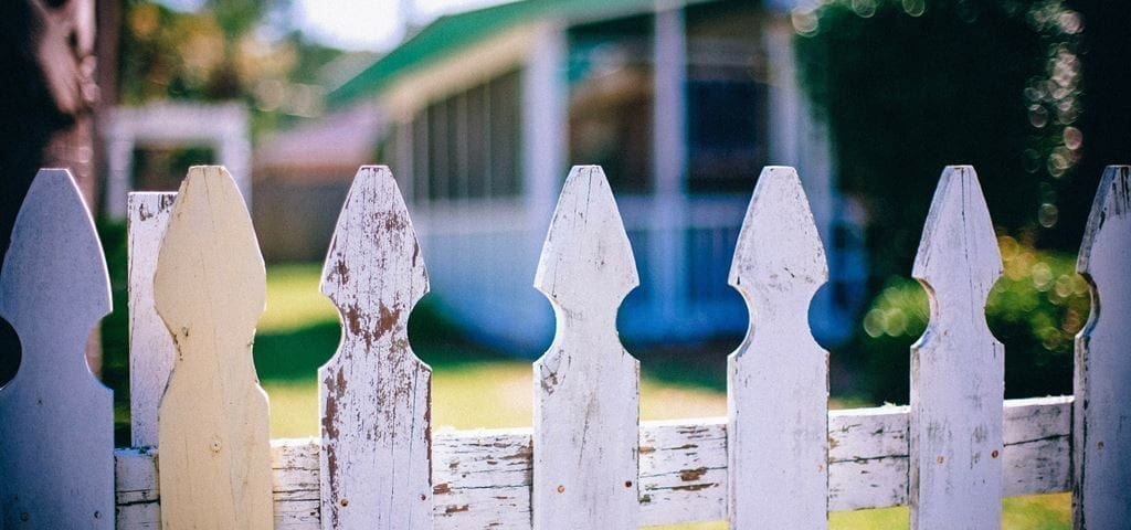 fence in front of house children
