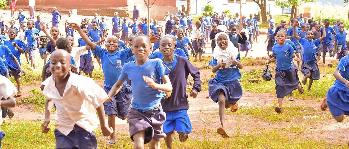 School children in Tanzania celebrating the end of the school year
