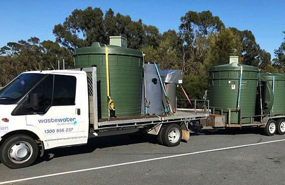 septic tanks on truck being delivered